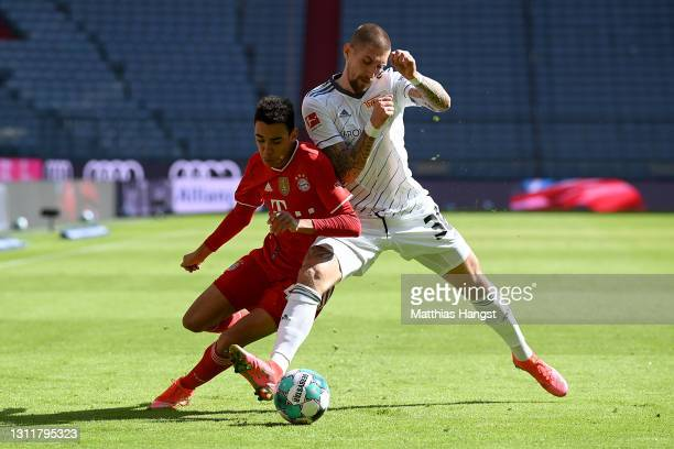 Jamal Musiala of FC Bayern Muenchen battles for possession with Robert Andrich of 1.FC Union Berlin during the Bundesliga match between FC Bayern...