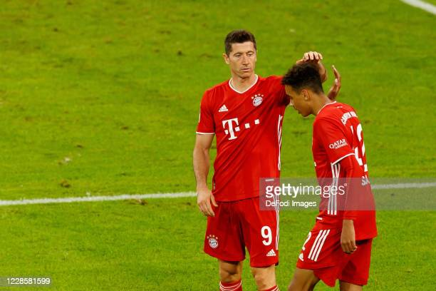 Jamal Musiala of FC Bayern Muenchen celebrates after scoring his team's eighth goal with Robert Lewandowski of FC Bayern Muenchen during the...