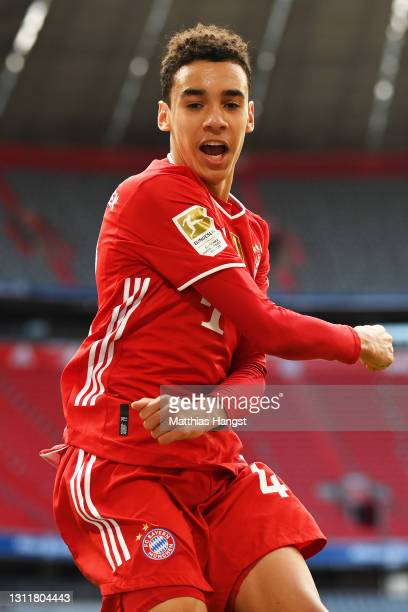 Jamal Musiala of FC Bayern Muenchen celebrates after scoring their team's first goal during the Bundesliga match between FC Bayern Muenchen and 1. FC...
