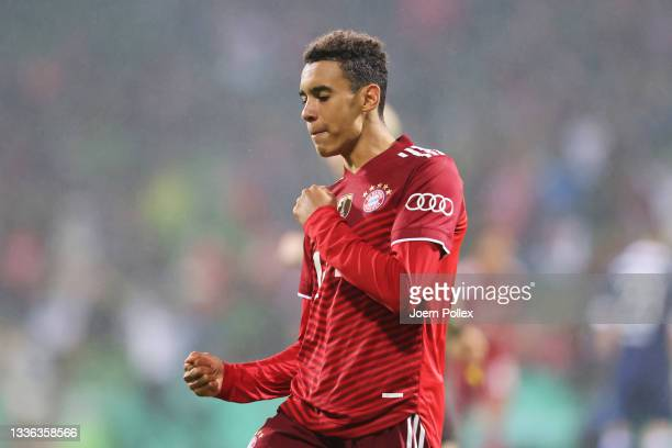Jamal Musiala of FC Bayern Muenchen celebrates after scoring their team's seventh goal during the DFB Cup first round match between Bremer SV and...