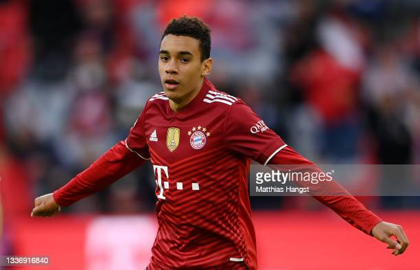 Jamal Musiala of FC Bayern Muenchen celebrates after scoring their sides third goal during the Bundesliga match between FC Bayern München and Hertha...
