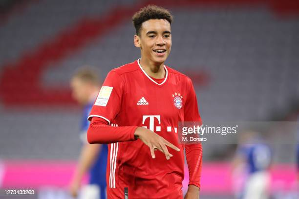Jamal Musiala of FC Bayern Muenchen celebrates scoring his teams eighth goal during the Bundesliga match between FC Bayern Muenchen and FC Schalke 04...