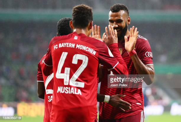 Jamal Musiala of FC Bayern Muenchen celebrates with teammate Eric Maxim Choupo-Moting after scoring their team's second goal during the DFB Cup first...