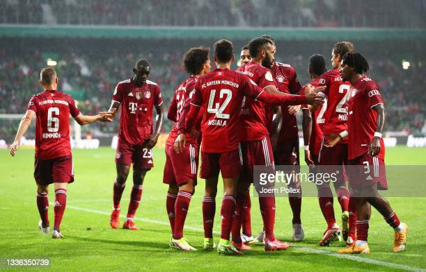Jamal Musiala of FC Bayern Muenchen celebrates with teammates after scoring their team's second goal during the DFB Cup first round match between...