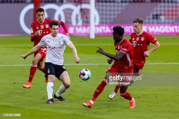 Jamal Musiala of FC Bayern Muenchen, Florian Neuhaus of Borussia Moenchengladbach, Alphonso Davies of FC Bayern Muenchen and Joshua Kimmich of FC...