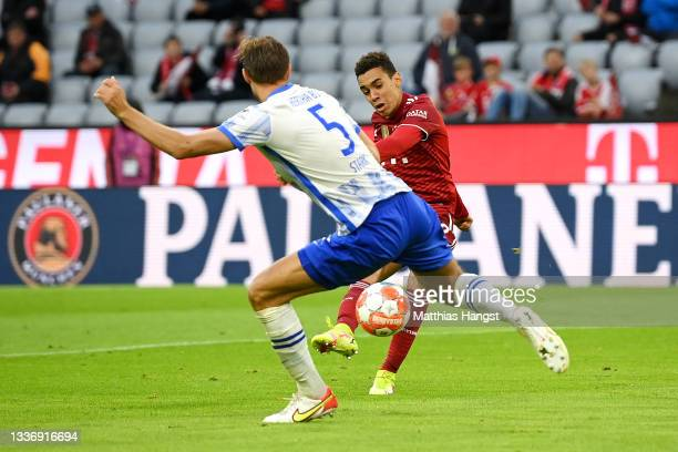 Jamal Musiala of FC Bayern Muenchen scores their sides third goal during the Bundesliga match between FC Bayern München and Hertha BSC at Allianz...
