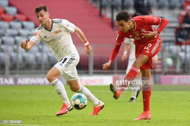 Jamal Musiala of FC Bayern Muenchen scores their team's first goal during the Bundesliga match between FC Bayern Muenchen and 1. FC Union Berlin at...