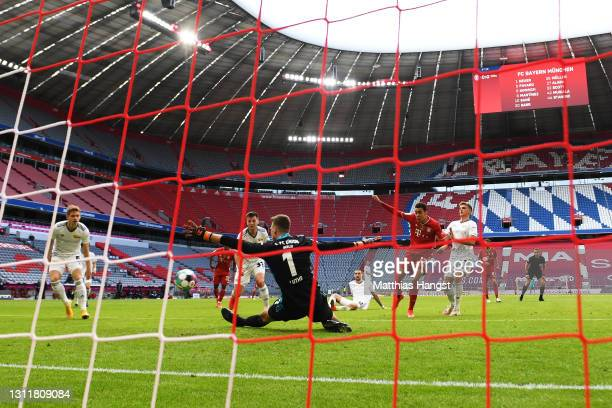 Jamal Musiala of FC Bayern Muenchen scores their team's first goal past Andreas Luthe of 1.FC Union Berlin during the Bundesliga match between FC...