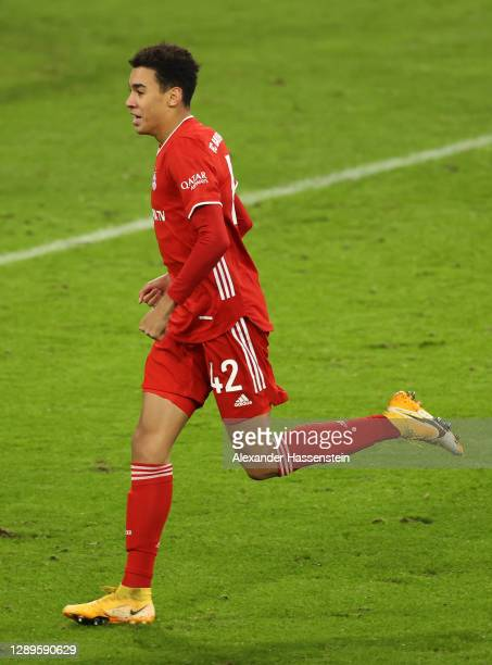 Jamal Musiala of FC Bayern Munich celebrates after scoring his team's first goal during the Bundesliga match between FC Bayern Muenchen and RB...