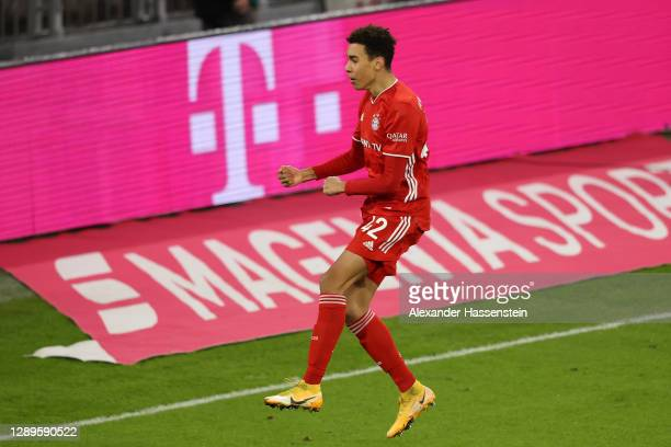 Jamal Musiala of FC Bayern Munich celebrates scoring his sides first goal during the Bundesliga match between FC Bayern Muenchen and RB Leipzig at...