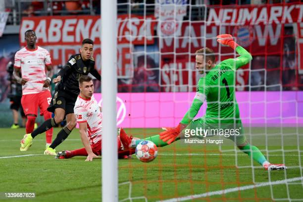 Jamal Musiala of Muenchen scores his teams second goal against Peter Gulacsi of Leipzig during the Bundesliga match between RB Leipzig and FC Bayern...