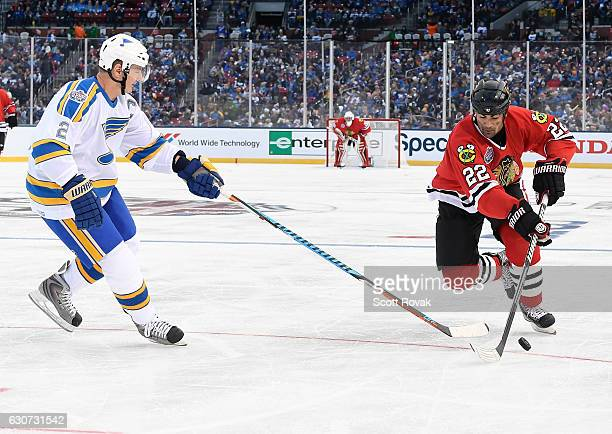 Jamal Myers of the Chicago Blackhawks and Al MacInnis of the St Louis Blues battle for the puck during the 2017 Bridgestone NHL Winter Classic Alumni...