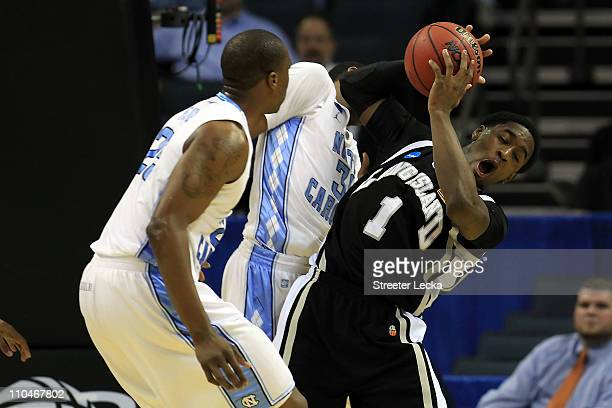 Jamal Olasewere of the Long Island Blackbirds reacts alongside John Henson of the North Carolina Tar Heels in the first half during the second round...