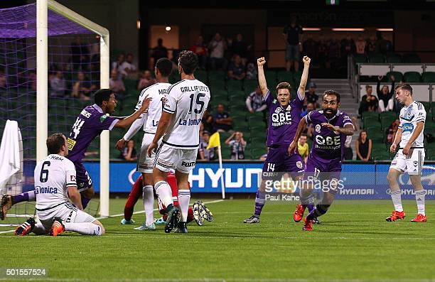 Jamal Reiners Chris Harold and Diego Castro of the Glory celebrate a goal during the round five ALeague match between the Perth Glory and Melbourne...