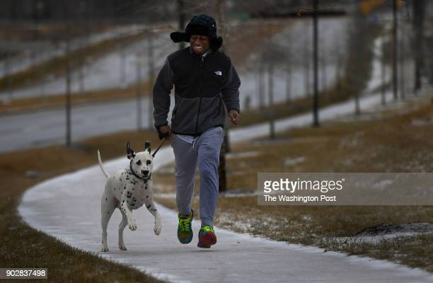 Jamal Richardson admitted that the road and sidewalk surfaces were a bit slick today but he had the help of his surefooted fourlegged jogging partner...
