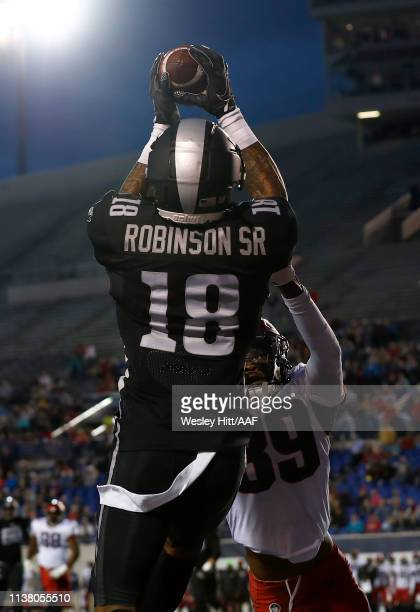 Jamal Robinson Jr of the Birmingham Iron makes a catch against Jeremy Cutrer of the Memphis Express during the first quarter of their Alliance of...
