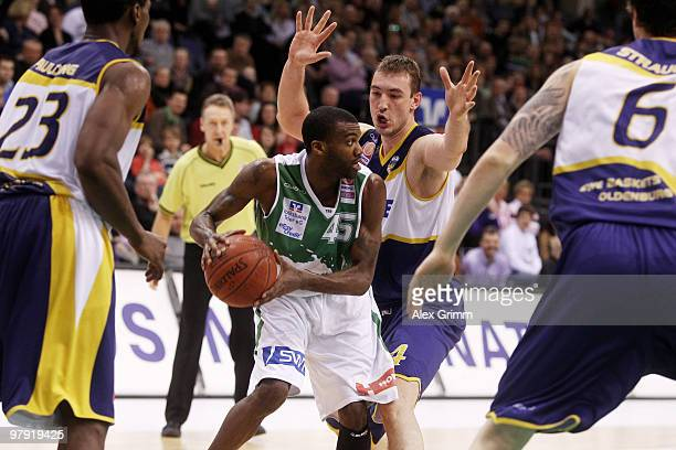 Jamal Shuler of moves against Rickey Paulding Marko Scekic and Daniel Strauch of Oldenburg during the Beko BBL basketball match between TBB Trier and...