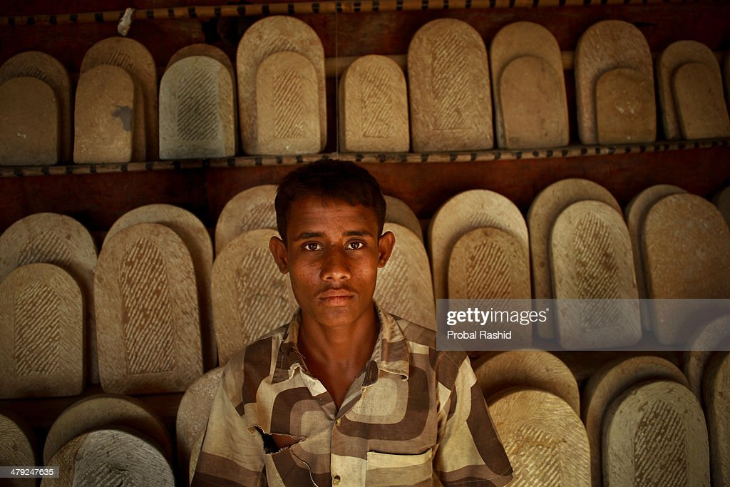 Jamal (aged 14), works at a stone carving factory. More than... : News Photo