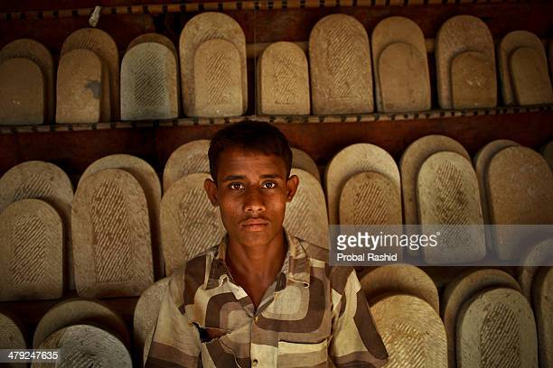 Jamal works at a stone carving factory More than 2000 men women and children are engaged in the stone carving industry along the river bank