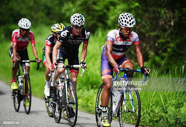 Jamalldin Novardianto of Pegasus Continental Cycling Team Indonesia leads follow by Oscar Pujol Munoz of Skydive Dubai Pro Cycling Team Edgar Nohales...