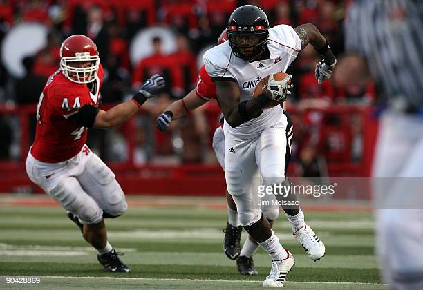 Jamar Howard of the Cincinnati Bearcats runs the ball past Ryan D'Imperio of the Rutgers Scarlet Knights at Rutgers Stadium on September 7 2009 in...