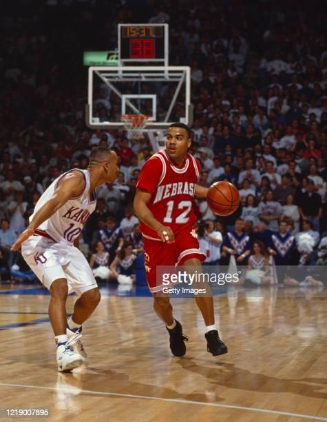 Jamar Johnson, Guard for the University of Nebraska Cornhuskers dribbles past Calvin Rayford of the University of Kansas Jayhawks during the NCAA Big...