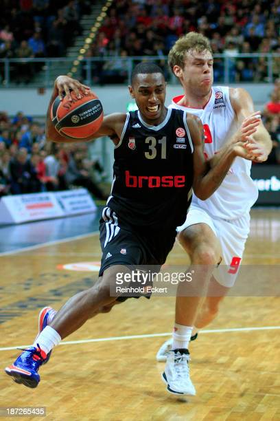 Jamar Smith, #31 of Brose Baskets Bamberg competes with Nicolo Melli, #9 of EA7 Emporio Armani Milan during the 2013-2014 Turkish Airlines Euroleague...