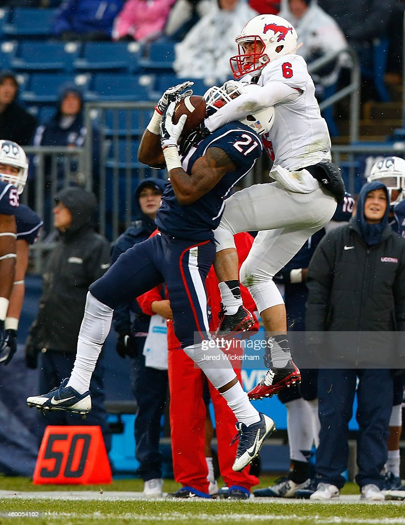 Jamar Summers #21 of the Connecticut Huskies intercepts a pass in front of Stephen Nelson #6 of the SMU Mustangs in the second quarter during the game at Rentschler Field on December 6, 2014 in East Hartford, Connecticut.