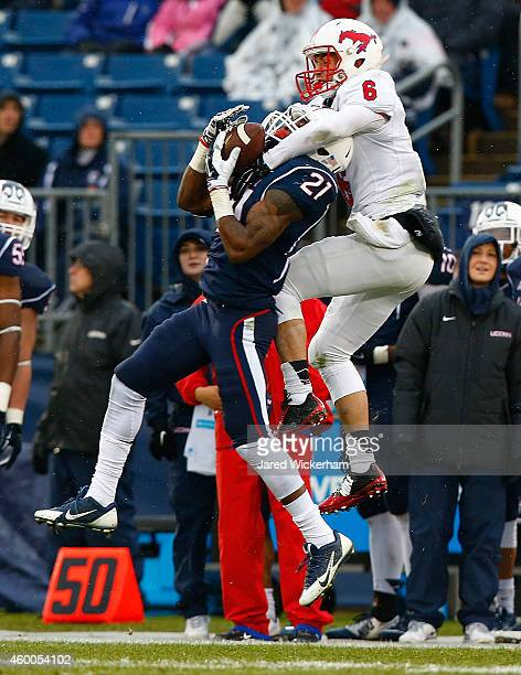 Jamar Summers of the Connecticut Huskies intercepts a pass in front of Stephen Nelson of the SMU Mustangs in the second quarter during the game at...