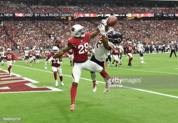 Jamar Taylor of the Arizona Cardinals knocks the pass away from Allen Robinson II of the Chicago Bears during the first half at State Farm Stadium on...