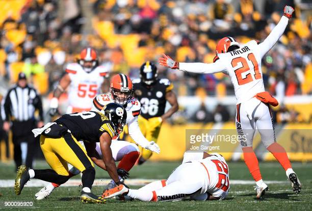 Jamar Taylor of the Cleveland Browns reacts after an interception by Jabrill Peppers in the first quarter during the game against the Pittsburgh...