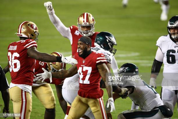 Jamar Taylor of the San Francisco 49ers celebrates with teammate Dion Jordan after a sack against Carson Wentz of the Philadelphia Eagles in the...