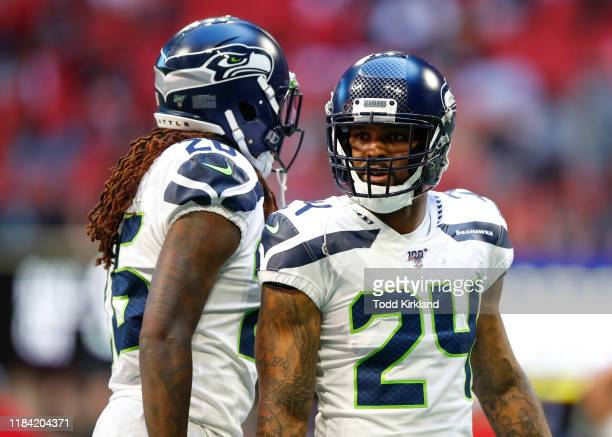 Jamar Taylor speaks with Shaquill Griffin of the Seattle Seahawks in the second half of an NFL game against the Atlanta Falcons at Mercedes-Benz...
