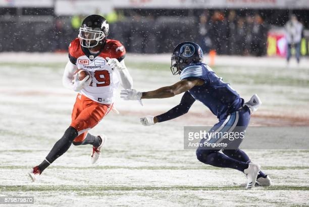 Jamar Wall of the Calgary Stampeders runs with the ball after a catch against Jermaine Gabriel of the Toronto Argonauts during the second half of the...