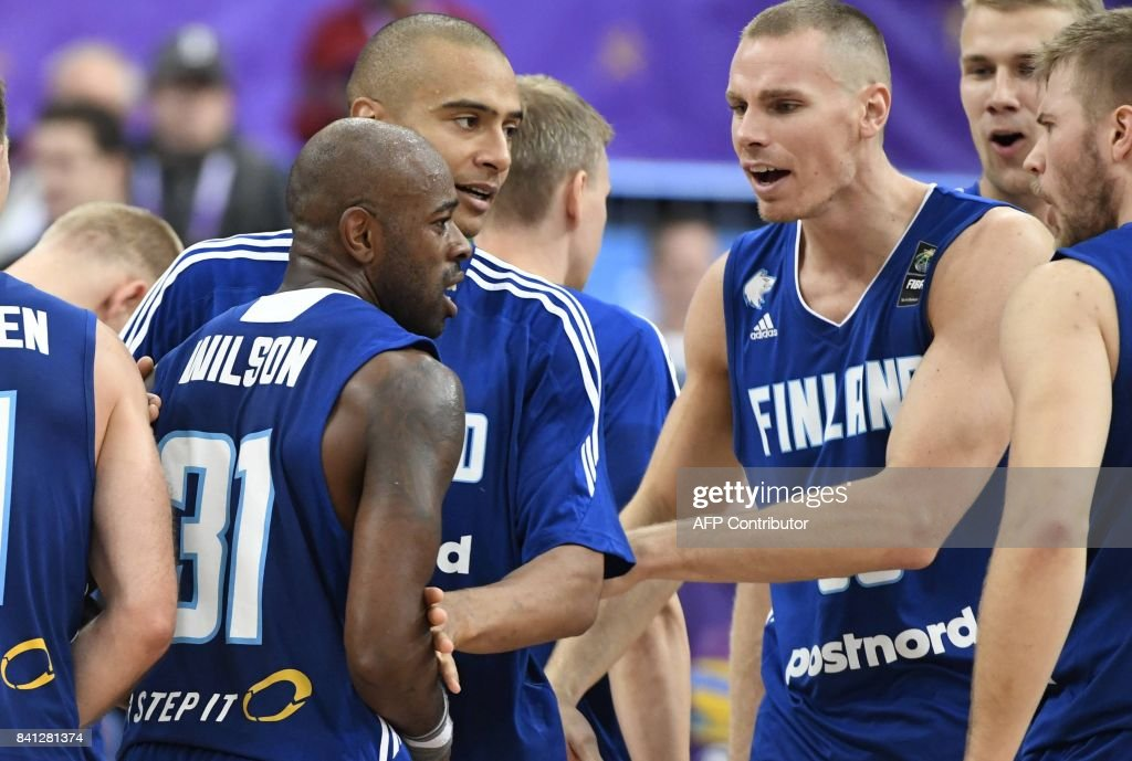 Jamar Wilson (L) of Finland is congratulated by his teammates after he scored the winning basket during the basketball European Championships Eurobasket 2017 qualification round Group A match France vs Finland in Helsinki, Finland on August 31, 2017. / AFP PHOTO / Lehtikuva / Jussi Nukari / Finland OUT