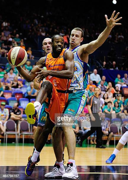 Jamar Wilson of the Taipans looks to pass the ball past Greg Vanderjagt of the Crocodiles during the round 15 NBL match between the Townsville...