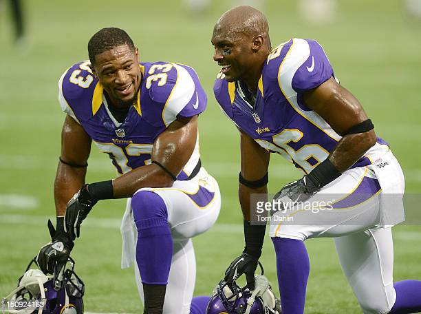 Jamarca Sanford and Antoine Winfield of the Minnesota Vikings take a break during warmups prior to an NFL game against the San Diego Chargers at Mall...
