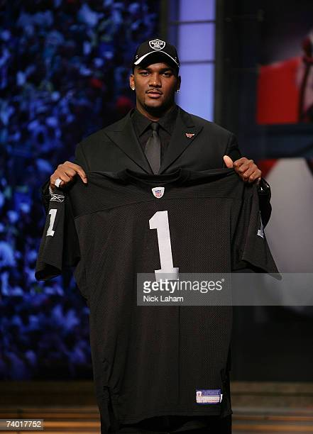JaMarcus Russell poses with his Oakland Raiders jersey after being chosen first overall by the Oakland Raiders at the 2007 NFL Draft at Radio City...