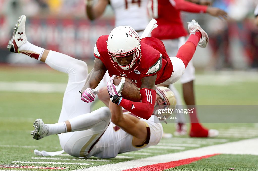 Jamari Staples #2 of the Louisville Cardinals dives for extra yardage against the Boston College Eagles at Papa John's Cardinal Stadium on October 24, 2015 in Louisville, Kentucky.