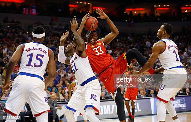 Jamari Traylor of the Kansas Jayhawks and Diamond Stone of the Maryland Terrapins battle for a rebound in the first half during the 2016 NCAA Men's...