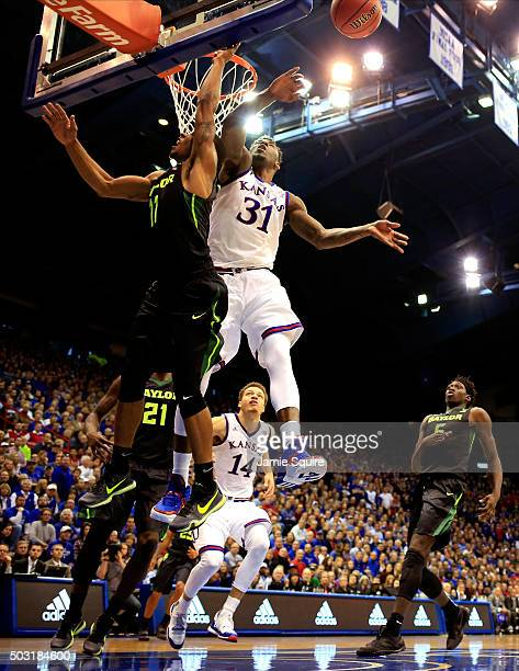 Jamari Traylor of the Kansas Jayhawks blocks a shot by Lester Medford of the Baylor Bears during the game at Allen Fieldhouse on January 2 2016 in...
