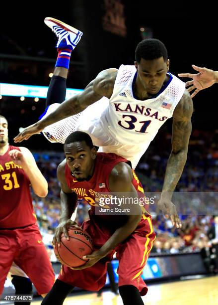 Jamari Traylor of the Kansas Jayhawks flips over Dustin Hogue of the Iowa State Cyclones during the Big 12 Basketball Tournament semifinal game at...