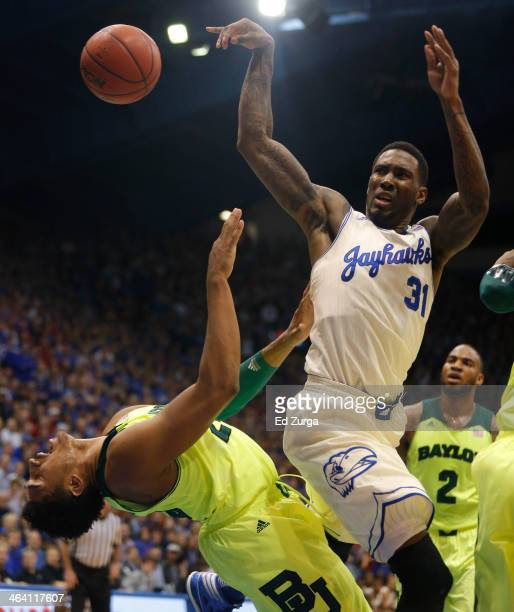 Jamari Traylor of the Kansas Jayhawks is fouled by Ish Wainright of the Baylor Bears as he shoots in the first half at Allen Fieldhouse on January 20...