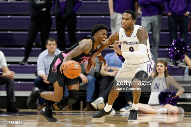 Jamari Wheeler of the Penn State Nittany Lions drives to the basket while being guarded by Vic Law of the Northwestern Wildcats during the second...