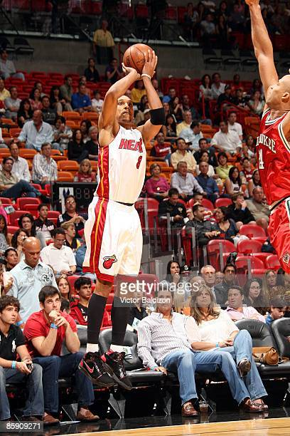 Jamario Moon of the Miami Heat shoots a jump shot against Richard Jefferson of Milwaukee Bucks during the game at American Airlines Arena on March 28...