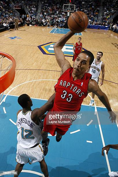 Jamario Moon of the Toronto Raptors dunks over Hilton Armstrong of the New Orleans Hornets on December 31 2007 at the New Orleans Arena in New...