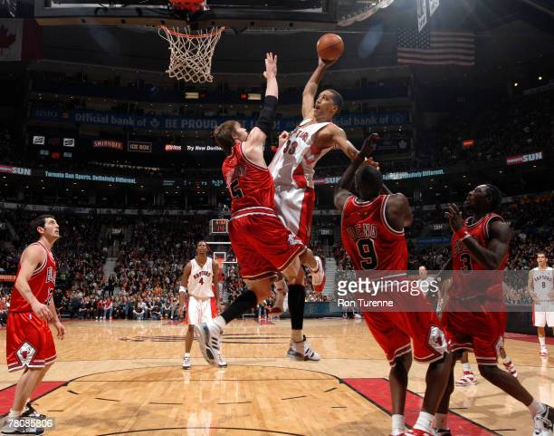 Jamario Moon of the Toronto Raptors goes up for a dunk against Andres Nocioni of the Chicago Bulls on November 25 2007 at the Air Canada Centre in...