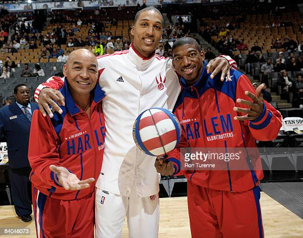 Jamario Moon of the Toronto Raptors poses with Curly Neal and Buckets Blakes of the Harlem Globetrotters before his game versus the New Jersey Nets...