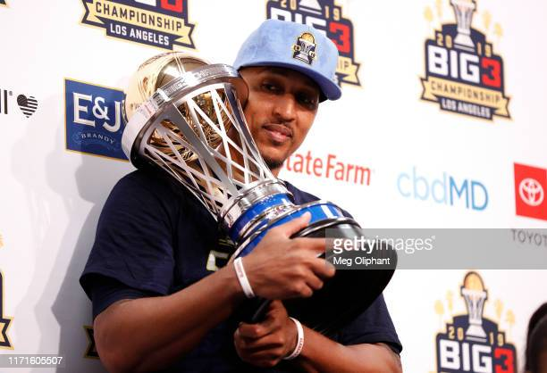 Jamario Moon of the Triplets attends the press conference holding the trophy after his team defeated the Killer 3s to win the BIG3 Championship at...