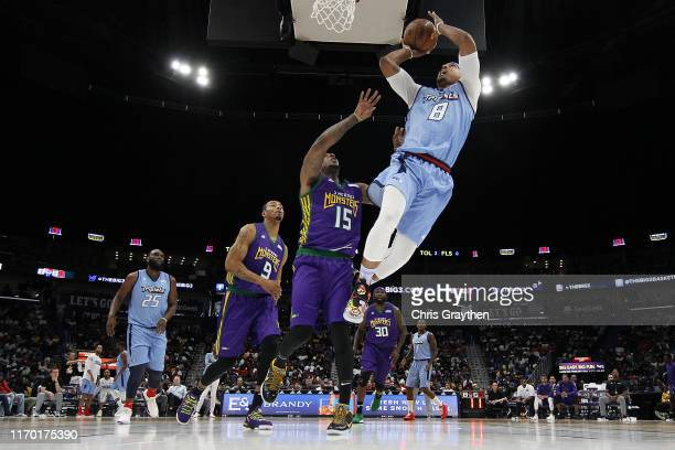 Jamario Moon of the Triplets shoots the ball over Mario Chalmers of the 3 Headed Monsters during the BIG3 Playoffs at Smoothie King Center on August...